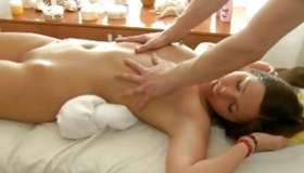 Stunning beauty looks perfect as long as sweetie is getting her body massaged